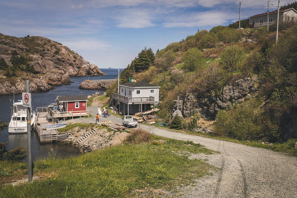 A couple walks to Quidi Vidi for their wedding photography in St. John's, Newfoundland