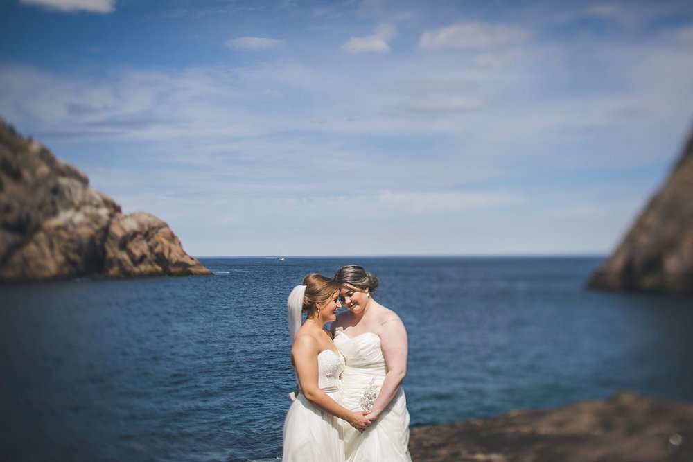 Same sex couple share a moment in Quidi Vidi for their wedding photography in St. John's, Newfoundland