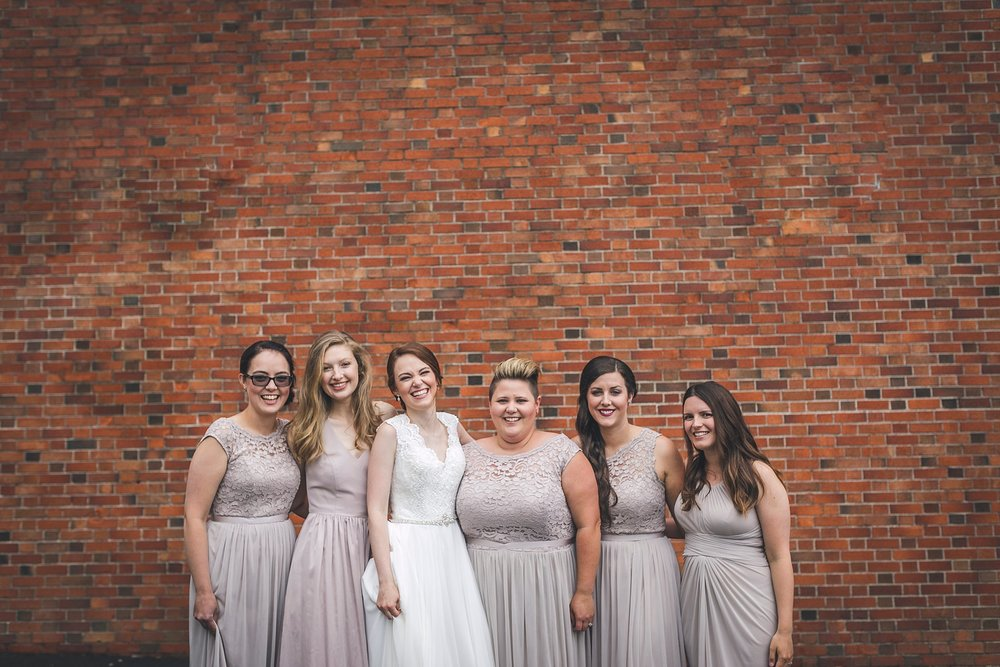 Wedding party shares laughter before the reception in downtown St. John's.