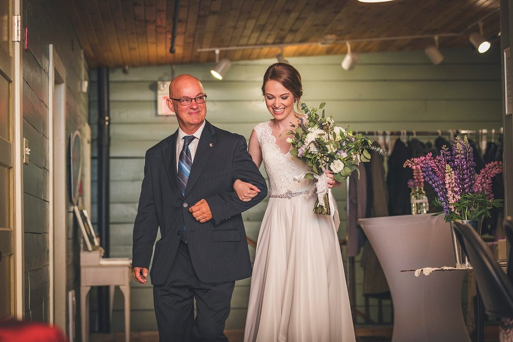 Bride and her father walk down the aisle during a wedding at the Rocket Room in downtown St. John's