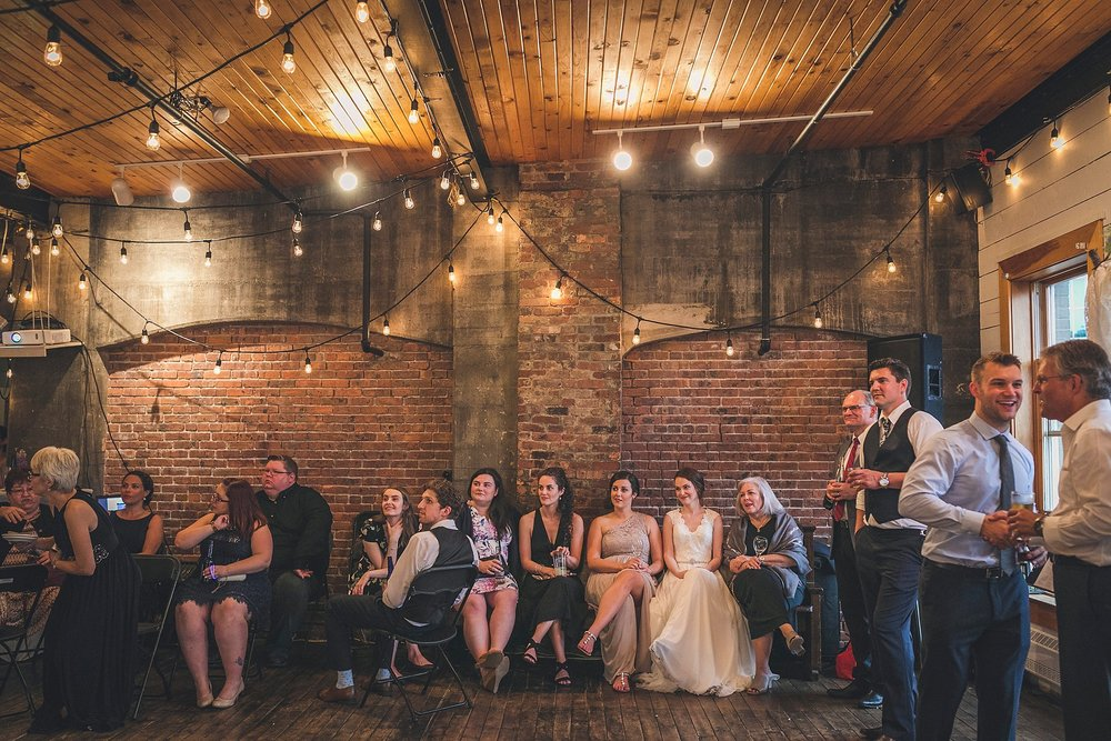 Bride and friends watch a slideshow during a St. John's, Newfoundland wedding held at The Rocket Room