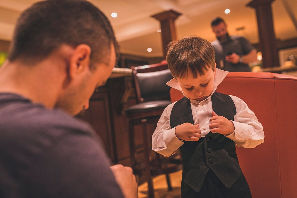 Groom helps his son prepare for wedding
