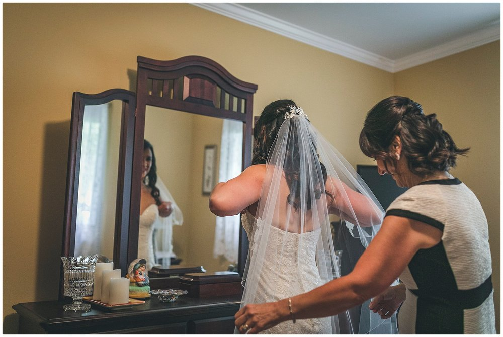 Mother of Bride helps her get dressed