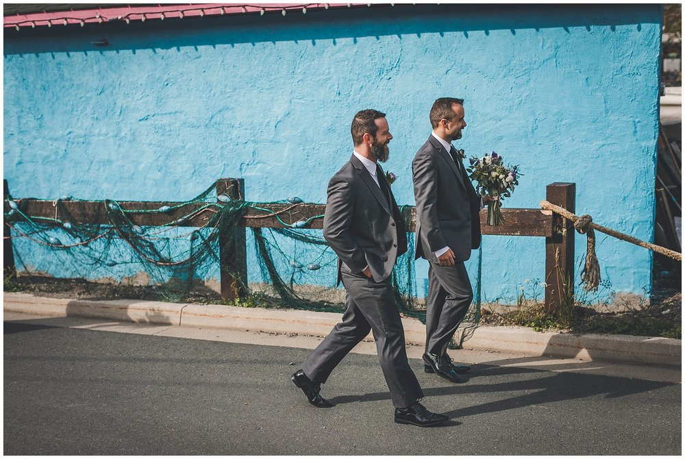 Groom and brother chat in Quidi Vidi