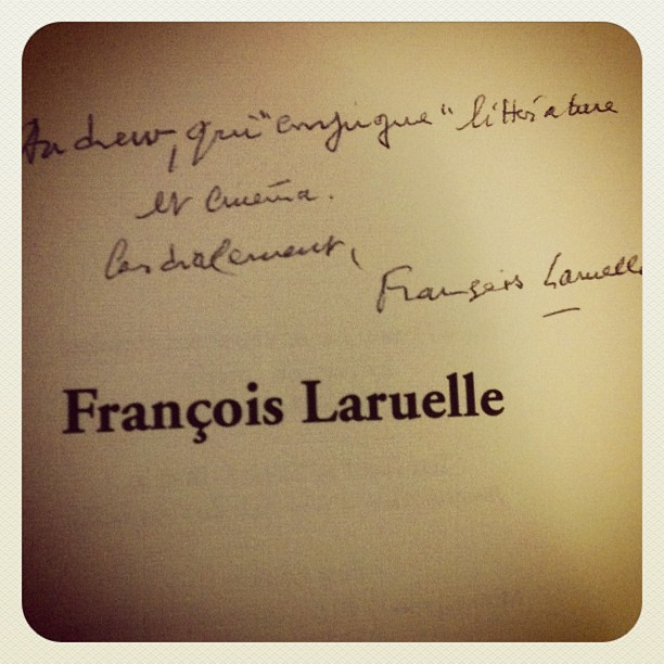 This is what happens when you speak French to a French philosopher, leading him on to think that you understand French better than you actually do: he uses an obscure compound pun in his inscription to your copy of his book, and you have no fucking clue what it means.