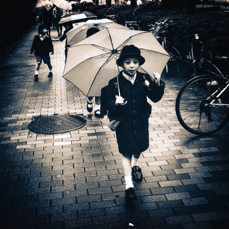 Kids leaving school in Aoyama on a cold, rainy day