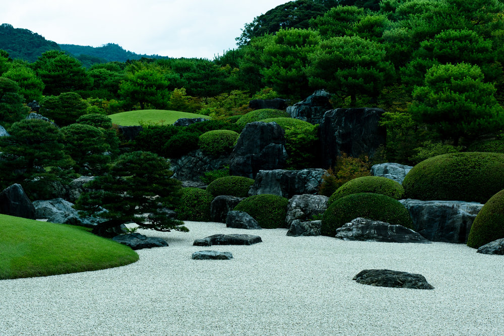 Stone arrangement in the Dry Landscape Garden. The three upright rocks in the center represent steep mountains, from which the water falls down into the white gravel in front.