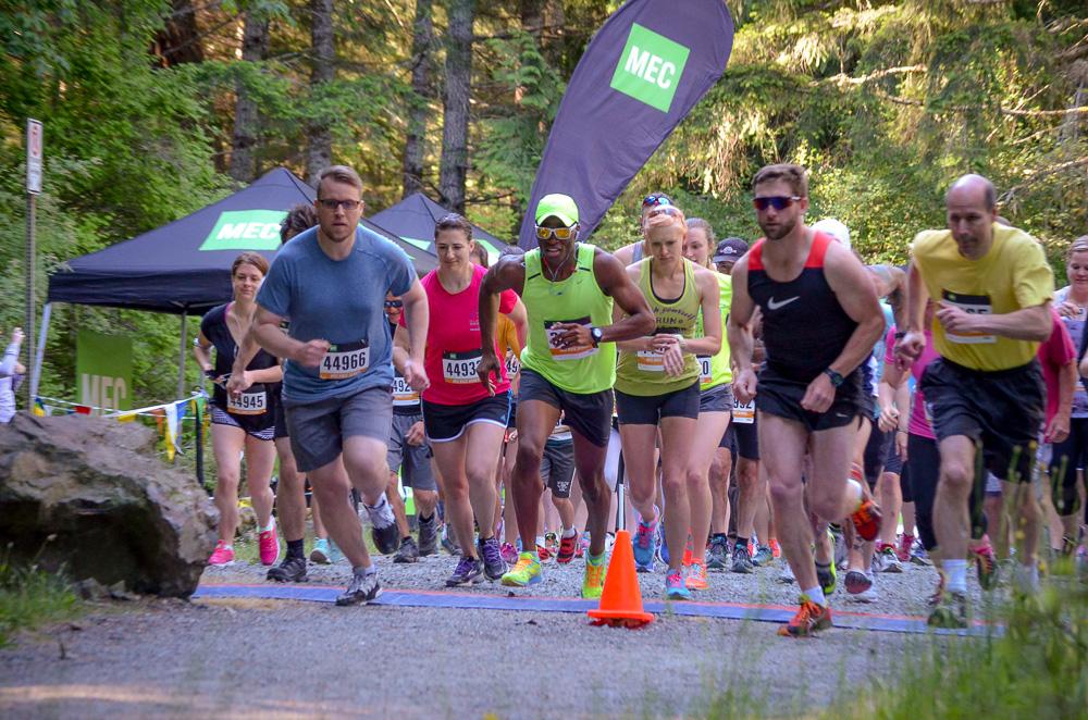 Amanda (center female in green singlet) racing the MEC Tape Breaker 5km - June 2015
