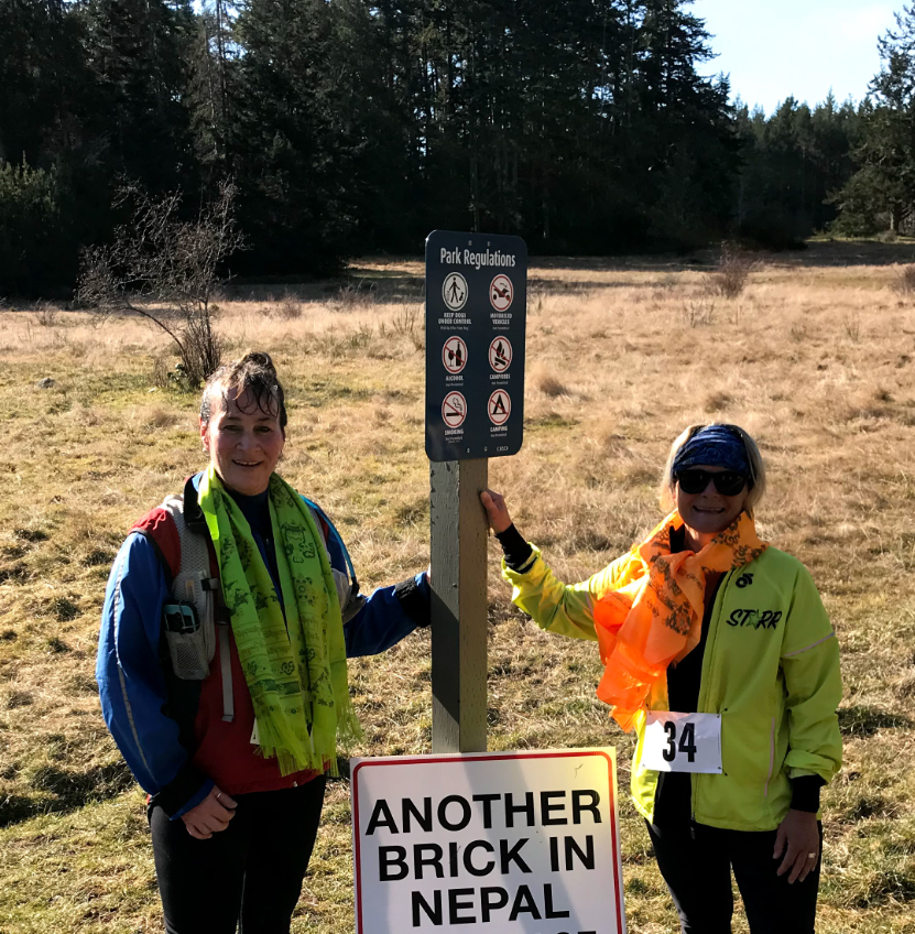 Carol, right, highly recommends the Another Brick in Nepal Trail Race!