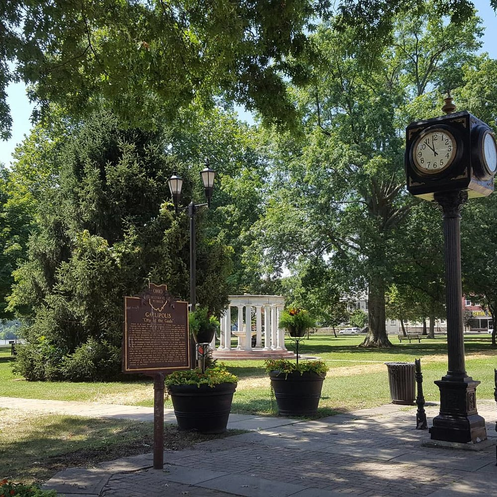 On the main drag Route 7 through Gallipolis. Beautiful city park facing the storefronts. Gorgeous views of the river, historical markers, and homes/museums. Stay a couple of days. Feel the river breeze on your face. Hop out onto the Serpent's Beard or try a local vineyard's wares.