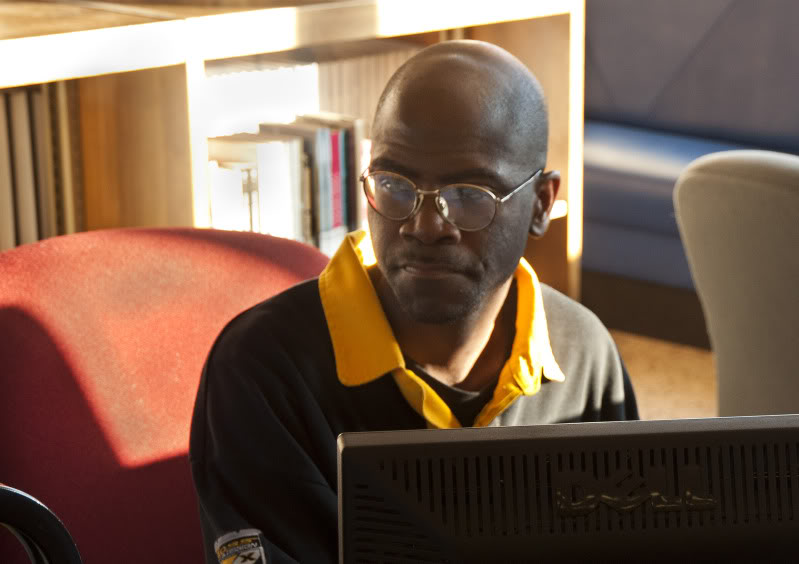 Charles Matthews checks a book into the Gary Public Library's system on the last day of the Central branch's operation.