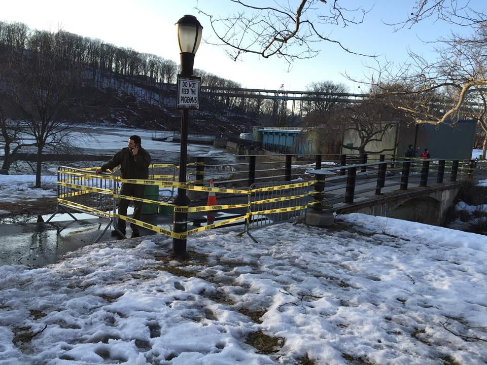 There is a massive sink hole in Inwood Hill Park on the walkway bridge that leads from the nature ce  nter's boat storage building southward towards the soccer field.