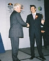 State Minister Kursad Tuzmen congratulated by WEPZA Director Robert Haywood