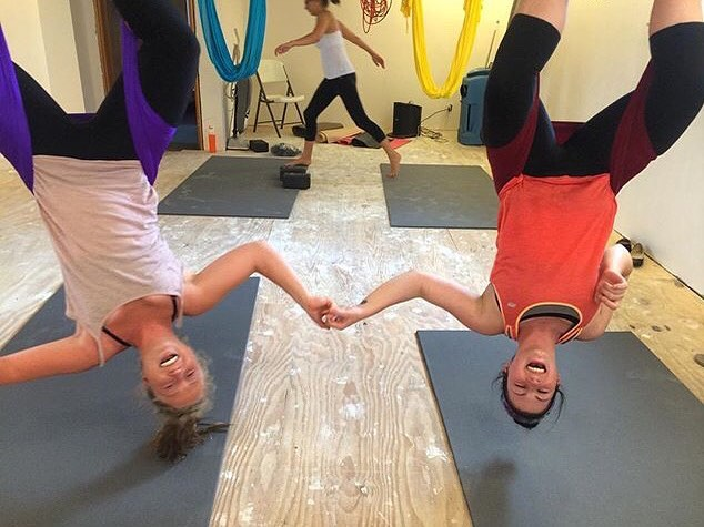 #tbt (a day late)  #aerial yogis Mariah and Nora hanging in the studio before it was finished being built, around August 2015