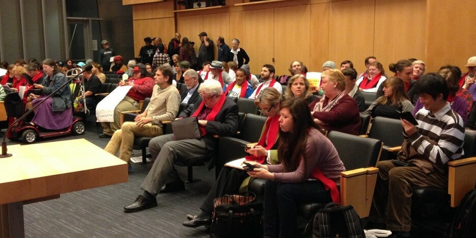 Supporters of SHSC's Budget Recommendation Package wear red scarves signifying their support.