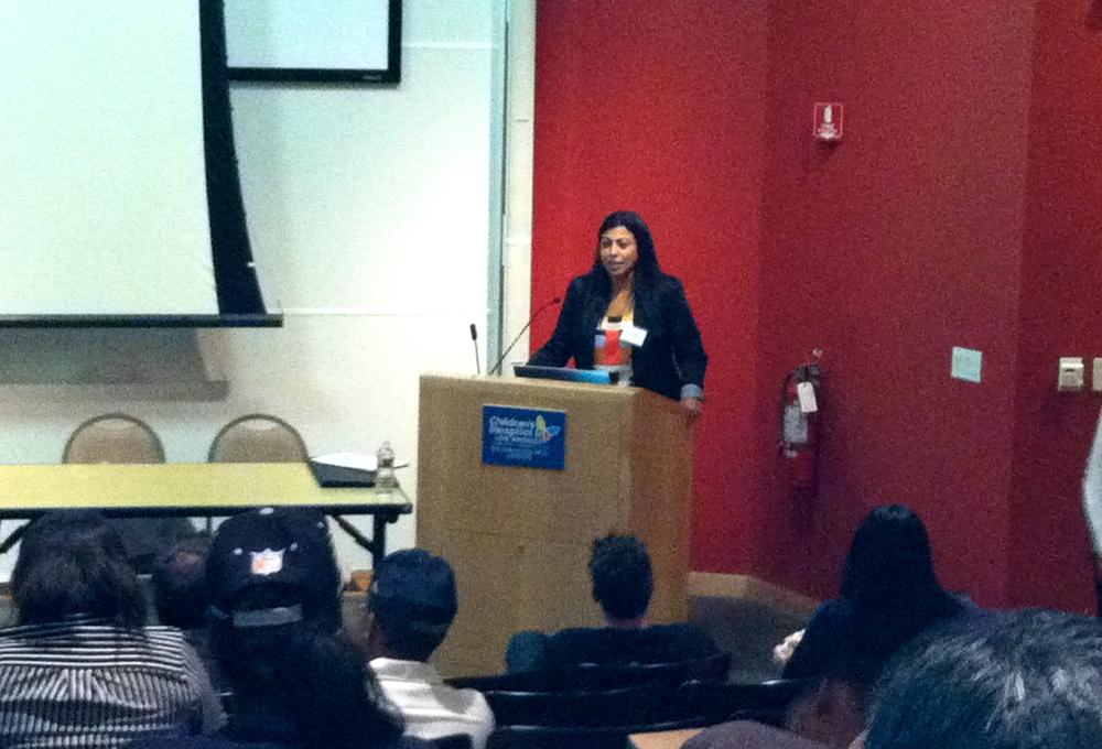 Meera speaking red  - Version 3.jpg