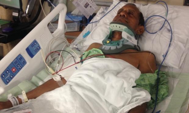 Sureshbhai Patel lies in hospital. Photograph: Hank Sherrod