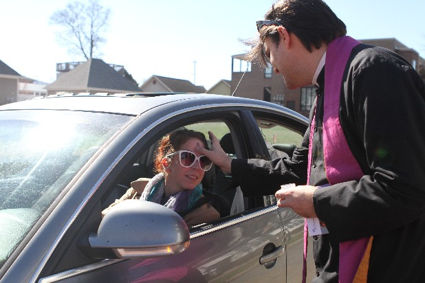Bob Leopold, a missioner at Southside Abbey, blesses Jama Jacks from her car on Ash Wednesday in Chattanooga. Ashes to Go is a movement through the Episcopal Church to bring Ash Wednesday to those who may not be able to make it to a service. (Photo by Maura Friedman/Times Free Press)