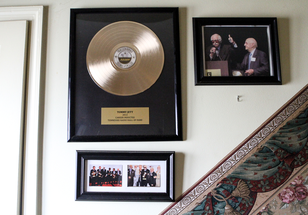 A gold record and photos from Jett's induction into the Tennessee Radio Hall of Fame hang above the stairs and next to the entrance of his home in Flintstone, Ga.
