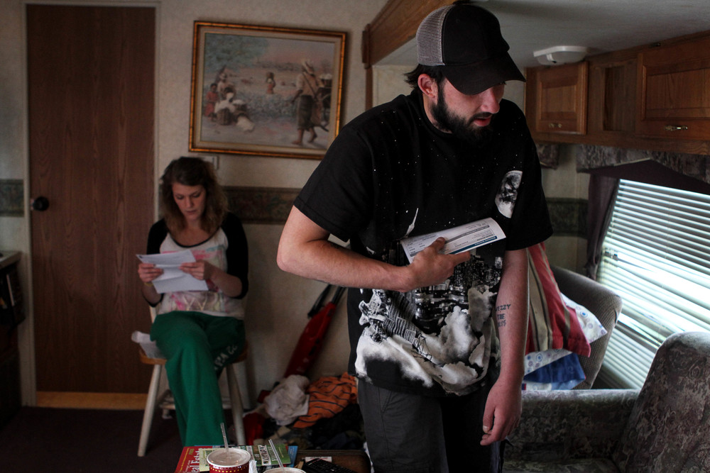 Ryan and Larae sort through bank statements. They're always saving – trying to scrape together first and last month's rent to get a place of their own. They're still a long ways off.