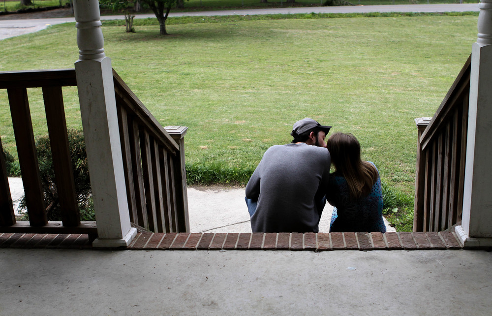 Ryan and Larae share a kiss on the steps of his mother's porch.
