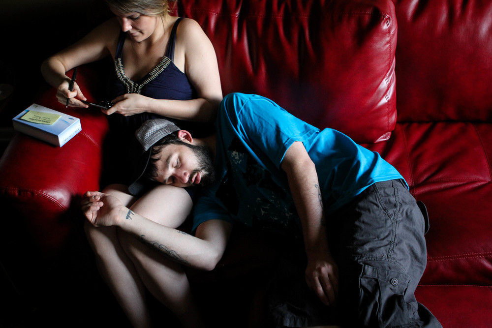 Ryan takes a nap on girlfriend Larae's lap at his mother's house. The two prefer to spend time there because it's air-conditioned and there's much more space, but Ryan and his mom have a tense relationship, so her home isn't always an option.
