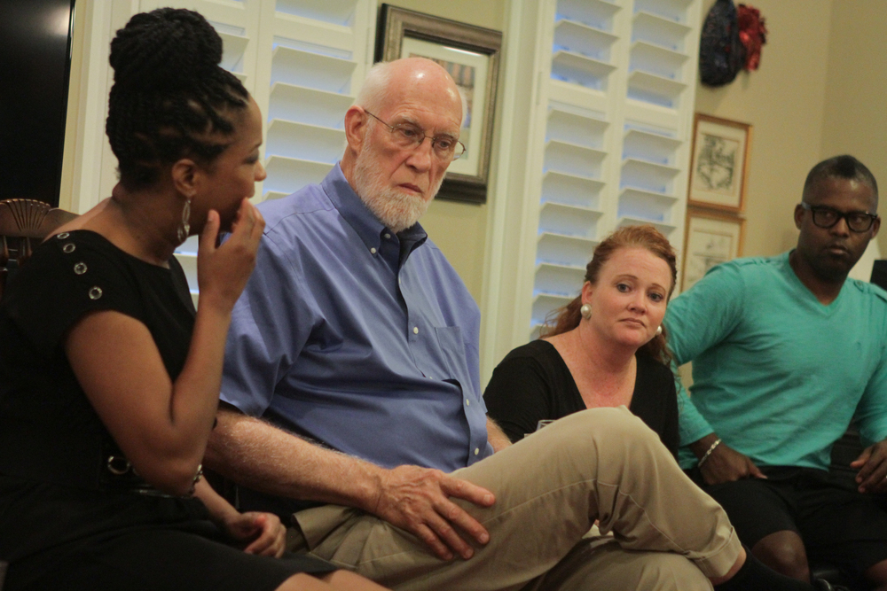 (From left) Stacy Lightfoot speaks as Franklin McCallie, Donna Christian-Lowe and Marty Lowe listen during a planning conversation at the McCallie home on Sept. 13, 2014.