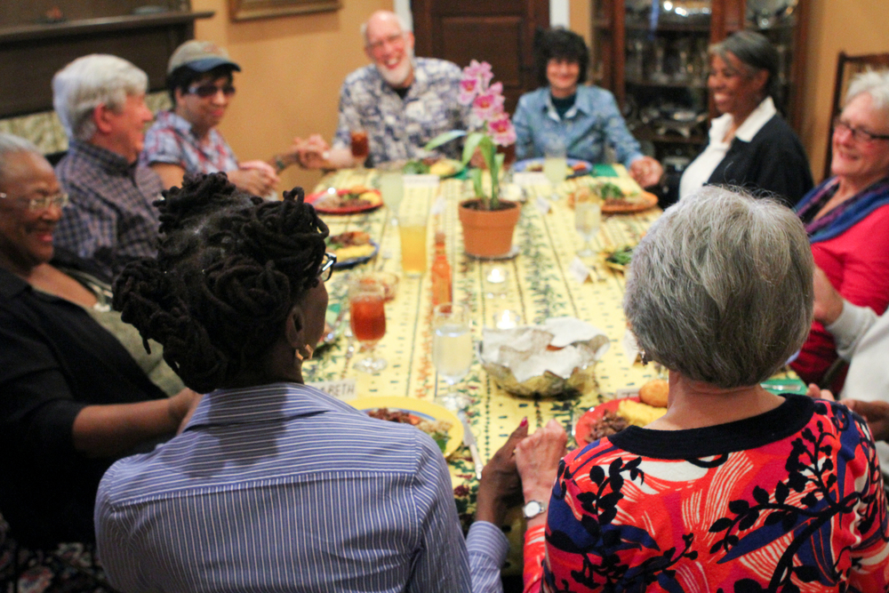 (From the far left and going clockwise) Dr. Evelena Holmes, Mel Cooper, Eva Jo Johnson, Franklin McCallie, Judy Schwartz, Donna Williams, Eleanor Cooper, Moses Freeman, Tresa McCallie and Elizabeth Williams hold hands during the welcoming at a potluck at the McCallie home in Chattanooga on May 2, 2014.