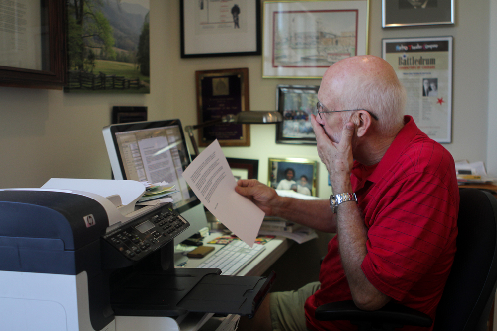 Franklin McCallie edits some writing in his home office on Sept, 18, 2014.