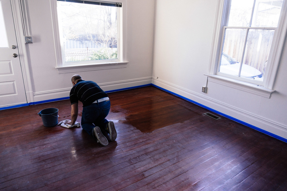 David making sure the floors are dust free prior to paint