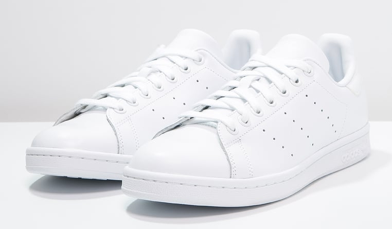Replace winter shoes with a pair of Adidas Stan Smiths. I found these ones found on  Zalando.fr