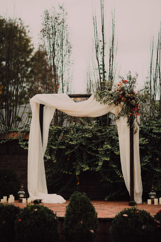 wedding arbor, asymmetrical flowers