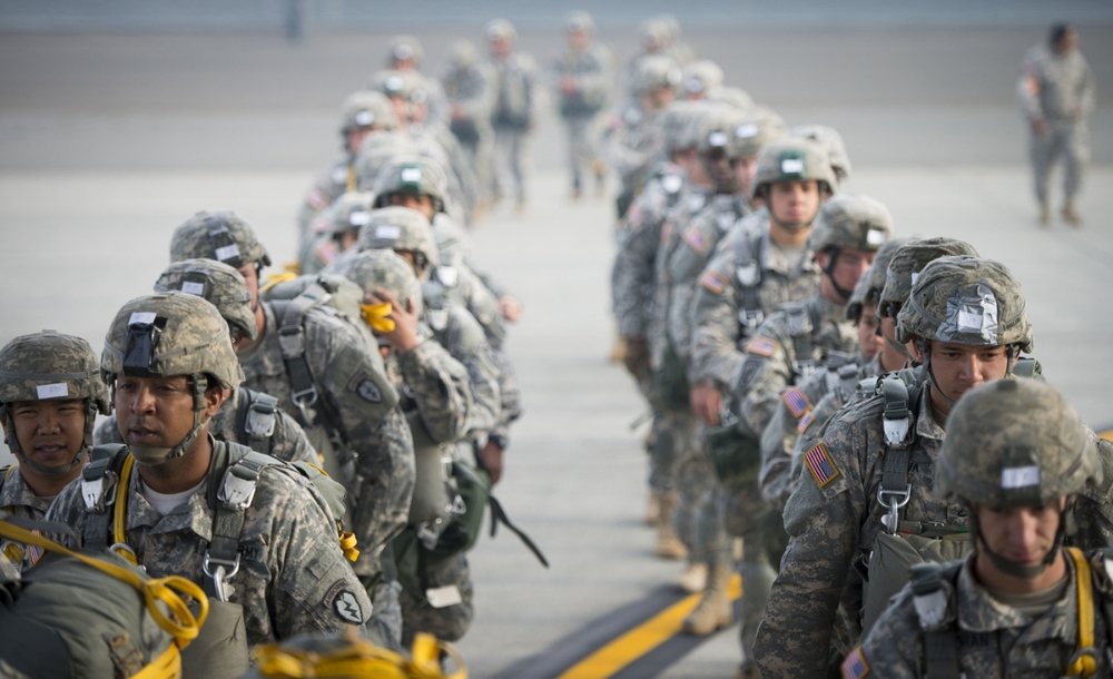 Army Paratroopers from the 725th Brigade Support Battalion prepare to board a C-130 Hercules from the 36th Airlift Squadron prior to a training sortie at Joint Base Elmendorf-Richardson, Alaska.
