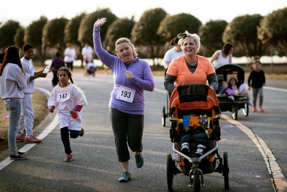Yokota members run towards the finish line Women's History Month Color Run, March 13, 2015, at Yokota Air Base, Japan. The run offered a chance for Yokota members to celebrate and spread awareness about the impact women have around the world. (U.S. Air Force photo by Airman 1st Class Delano Scott/Released)