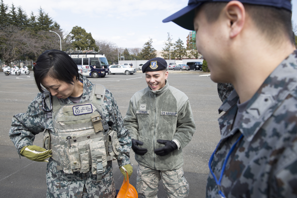 Japan Air Self-Defense Force Master Sgt. Tomomi Yamada, Air Tactics Development Wing, wears a tactical vest during the safety festival at Yokota Air Base, Japan, March 6, 2015. The 374th Airlift Wing Safety Office provided Yokota residents with various events such as the Tokyo Metropolitan Police Department motorcycle unit demonstration, traffic safety demonstration, earthquake and smoke house, firefighting experience, fire ladder trucks experience, 374th Security Forces Squadron patrol vehicle ride, seatbelt simulator and child car seat checks. (U.S. Air Force photo by Osakabe Yasuo/Released)