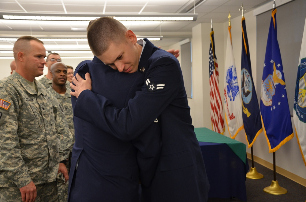 Airman Christian Frizzell, a student at the Medical Education and Training Campus, receives a hug from his father, Chief Master Sgt. Charles Frizzell, following his Biomedical Equipment Technician (BMET) class graduation ceremony April 10. Airman Frizzell is starting his new career at Wright-Patterson Air Force Base, Ohio. His father, also a BMET, is currently assigned as the senior enlisted advisor to the commander at the 374th Medical Group at Yokota Air Base, Japan. (Photo by Lisa Braun)