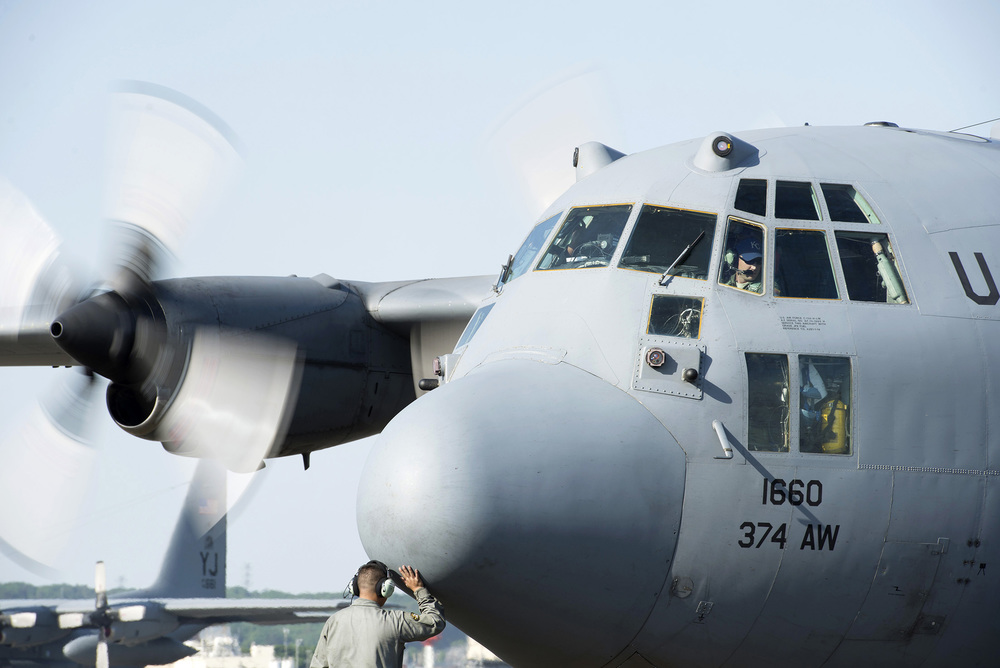 A crew chief with the 374th Aircraft Maintenance Squadron rubs the nose of a C-130 Hercules for good luck at Yokota Air Base, Japan, May 5, 2015. Members of Yokota left to provide humanitarian airlift and relief operations to support the U.S. Agency of International Development and the Government of Nepal in response to the 7.8 magnitude earthquake that devastated the country April 25, 2015. (U.S. Air Force photo by Staff Sgt. Cody H. Ramirez/Released)