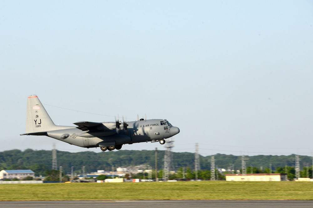 A C-130 Hercules takes off at Yokota Air Base, Japan, May 5, 2015. Members of Yokota left to provide humanitarian airlift and relief operations to support the U.S. Agency of International Development and the Government of Nepal in response to the 7.8 magnitude earthquake that devastated the country April 25, 2015. (U.S. Air Force photo by Staff Sgt. Cody H. Ramirez/Released)