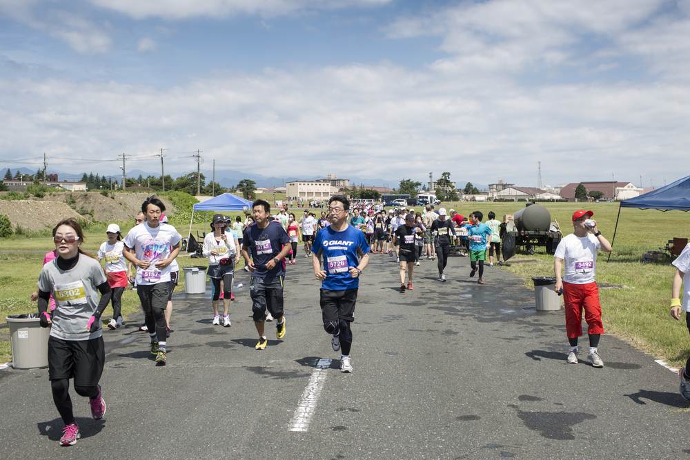Runners participate in the 31st annual Ekiden 5k run at Yokota Air Base, Japan, June 7, 2015. The Yokota Striders running club sponsored the annual Ekiden Run consisting of three different races at this event: a 4-person 5k relay, 5k race, and 2k Kid's Run. (U.S. Air Force photo by Osakabe Yasuo/Released)
