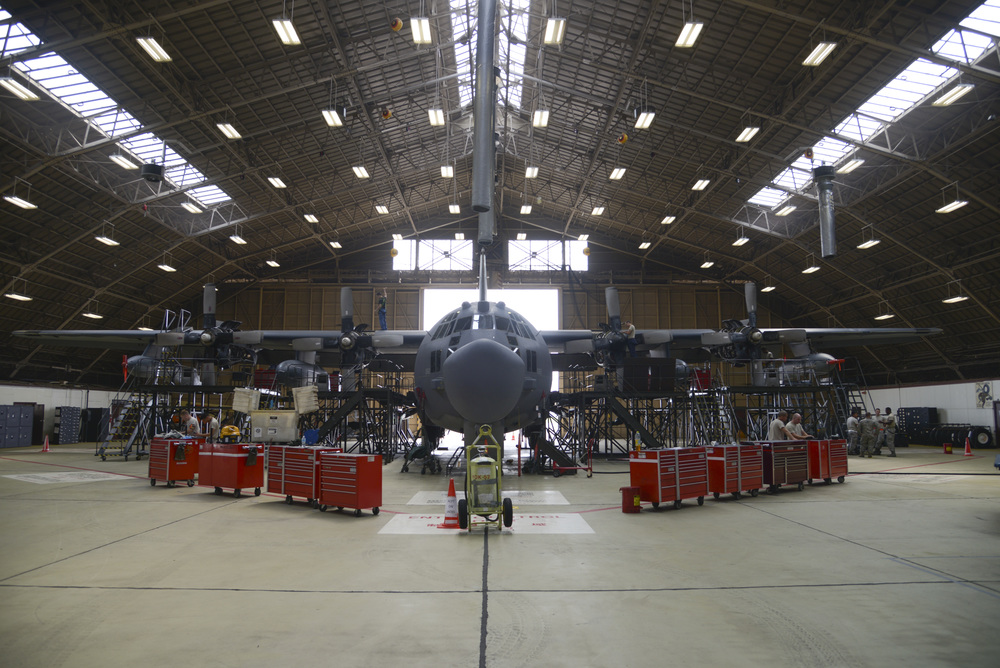 Members of the 374th Maintenance Squadron work on a MC-130H Combat Talon II from Kadena Air Base, Japan, at Yokota Air Base, Japan, June 16, 2015. The MC-130H provides infiltration, exfiltration and resupply of special operation forces and equipment in hostile or denied territory. (U.S. Air Force photo by Senior Airman David Owsianka/Released)