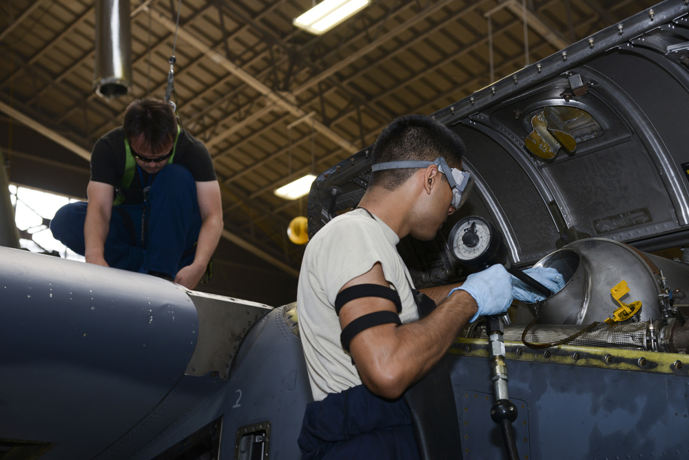 Members of the 374th Maintenance Squadron work on an MC-130H Combat Talon II from Kadena Air Base, Japan at Yokota Air Base, Japan, June 16, 2015. Secondary missions of the MC-130H include psychological operations and helicopter air refueling. (U.S. Air Force photo by Senior Airman David Owsianka/Released)