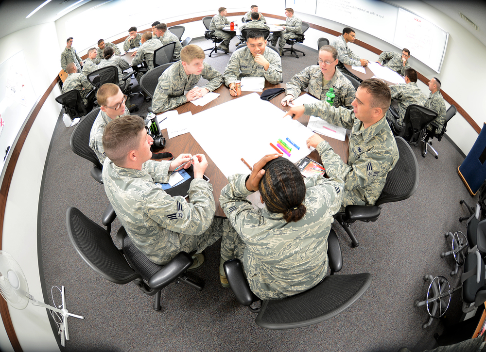 Airmen work together during a personality assessment session June 16, 2015, at the Professional Development Center at Yokota Air Base, Japan. The session titled the four lenses provides students at Airmen Leadership School an opportunity to discover their own personality and how to communicate with others. (U.S. Air Force photo by Senior Airman Desiree Economides/Released)