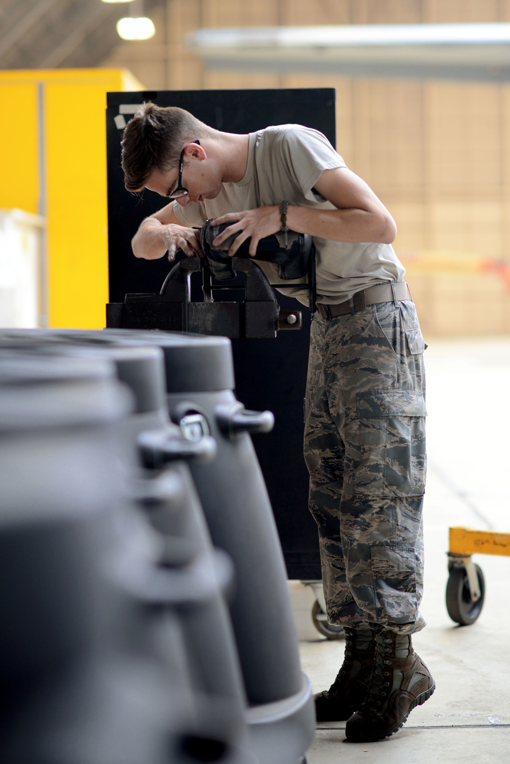 Senior Airman Michael Dalleo, 374th Maintenance Squadron crew chief, inspects a cushion from a C-130 Hercules, June 16, 2015, at Yokota Air Base, Japan. As part of the yearly isochronal inspection of a C-130 Hercules, 374 MXS Airmen worked to ensure the aircraft remains safe. (U.S. Air Force photo by Airman 1st Class Delano Scott/Released)