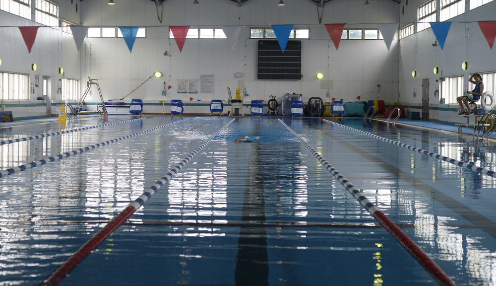 A member of Yokota Air Base, Japan, swims at the Natatorium Indoor Pool at Yokota AB, June 17, 2015. Swimming is a low-impact activity that has many physical and mental health benefits which provides a person with the ability to build endurance, muscular strength and cardiovascular fitness. (U.S. Air Force photo by Senior Airman David Owsianka/Released)