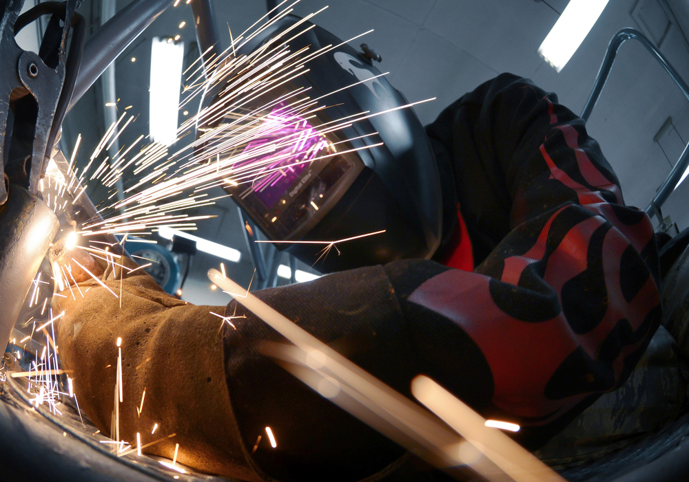 Airman 1st Class Curtis Doherty, 374th Maintenance Squadron aircraft metals technology journeyman, welds a post hole for a B-1 platform at Yokota Air Base, Japan, June 23, 2015. The average time it takes to fix or create a piece of equipment is approximately eight hours. (U.S. Air Force photo by Senior Airman David Owsianka/Released)