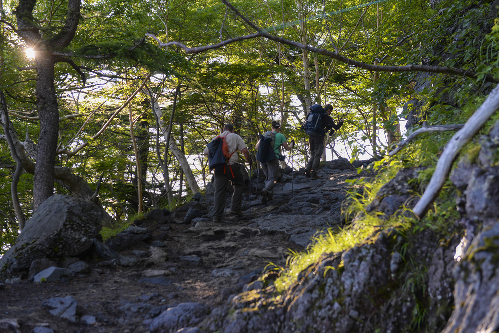 Participants of the Chief Master Sergeant of the Air Force resiliency climb of Mount Fuji, Japan, hike Yoshida trail on the way to the summit, July 11, 2015. To make sure all 86 hikers returned safely from the mountain, hikers traveled alongside a wingman, keeping each other motivated along the way. (U.S. Air Force photo by Airman 1st Class Elizabeth Baker/Released)