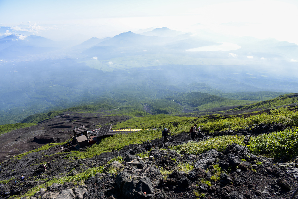 Hikers make their way up Yoshida trail to the summit of Mount Fuji Japan, July 11, 2015. Team Yokota members used teamwork and resiliency to make sure that all members returned safely from the mountain. (U.S. Air Force photo by Airman 1st Class Elizabeth Baker/Released)