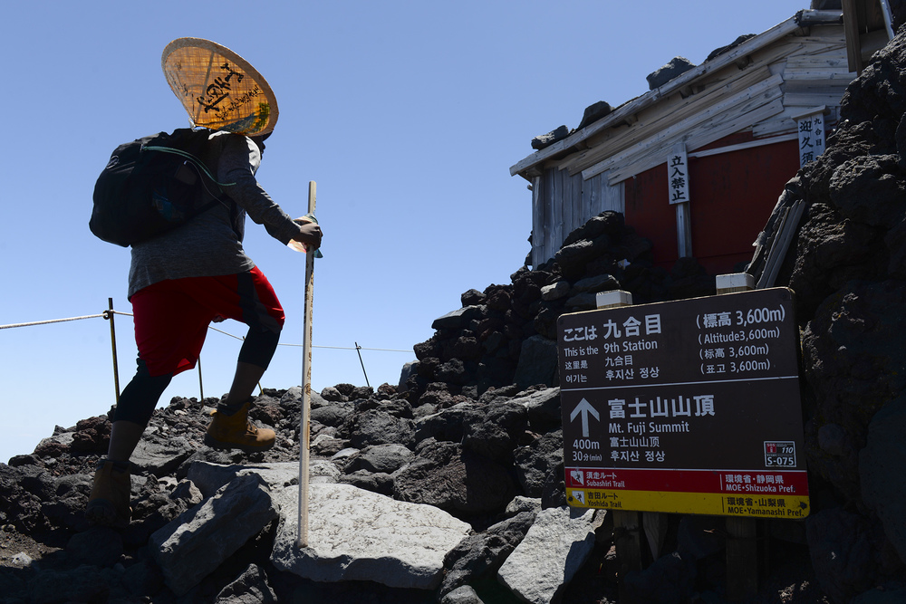 A hiker makes his way past the 9th station of Yoshida trail on Mount Fuji, Japan, July 11, 2015. To reach the summit of Mount Fuji, hikers had to climb over 5,000 ft., from the 5th station, taking anywhere from three to seven hours on average. (U.S. Air Force photo by Airman 1st Class Elizabeth Baker/Released)