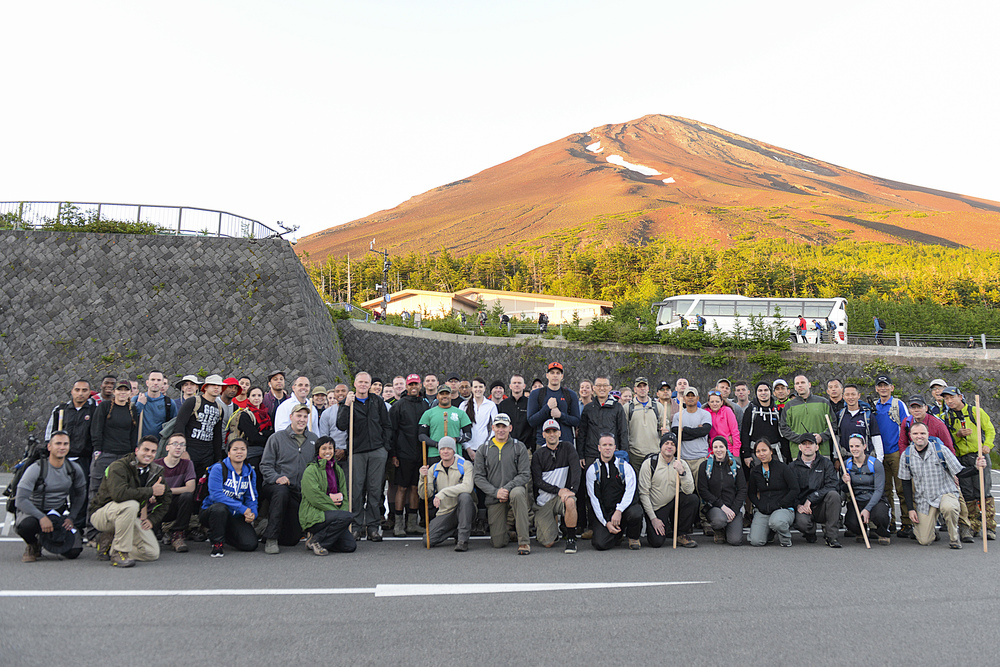Members of Team Yokota pose with Chief Master Sergeant of the Air Force James A. Cody at the 5th station before beginning the climb to the summit of Mount Fuji, Japan, July 11, 2015. Hikers bus to the 5th station at nearly 7,000 ft. altitude before beginning the trek. (U.S. Air Force photo by Airman 1st Class Elizabeth Baker/Released)