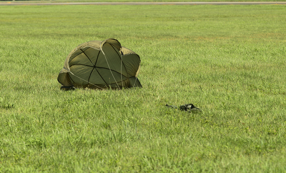 A sandbag hits the ground during a training exercise at Yokota Air Base, Japan, July 14, 2015. This exercise tested the squadron's ability to accurately drop cargo to a specific target. (U.S. Air Force photo by Senior Airman David Owsianka/Released)